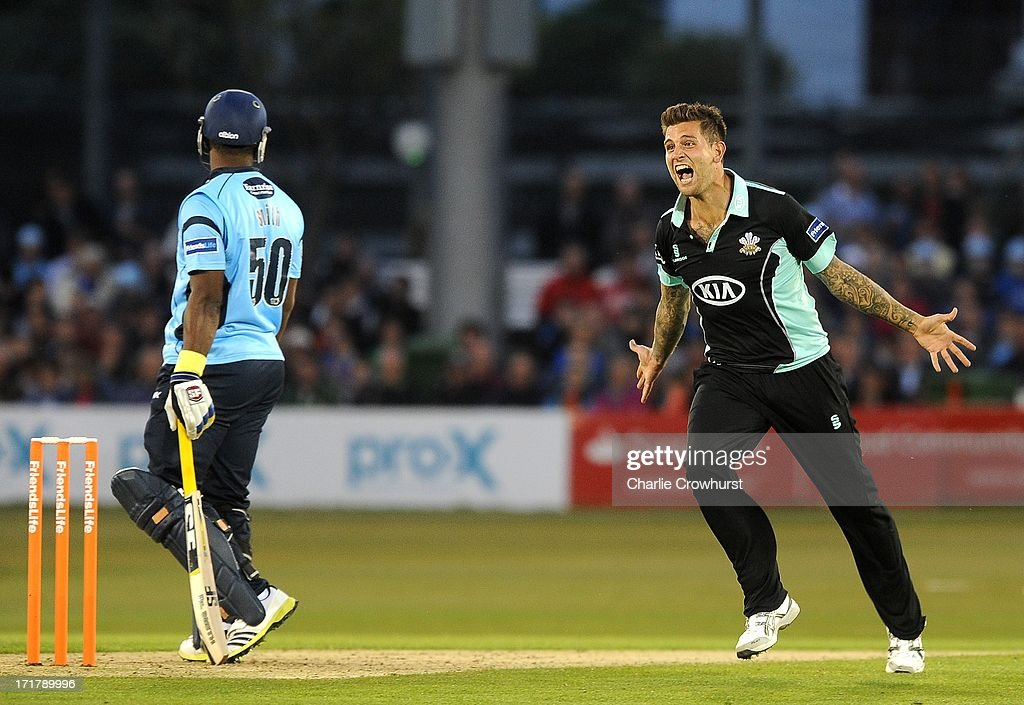Jade Dernbach of Surrey celebrates the wicket of Dwayne Smith of Sussex during the Friends Life T20 match between Sussex Sharks and Surrey Lions at...