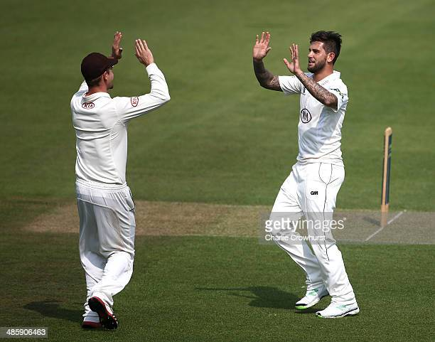 Jade Dernbach of Surrey celebrates with a team mate after taking the wicket of Essex's Jaik Mickleburgh during day two of the LV County Championship...
