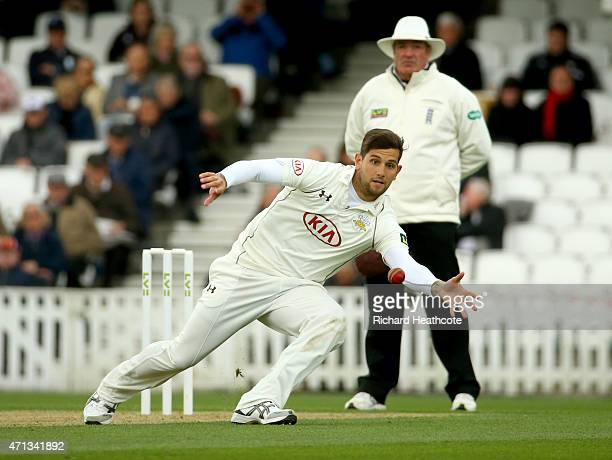 Jade Dernbach of Surrey dives to stop the ball during the LV County Championship match between Surrey and Essex at The Kia Oval on April 27 2015 in...