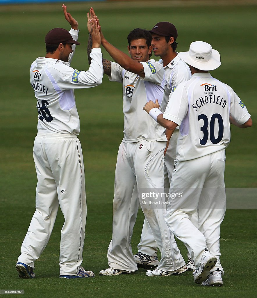 Jade Dernbach of Surrey is congratulated on the wicket of Rob White of Northamptonshire, after he was caught by Steve Davies during the LV County Championship match between Northamptonshire and Surrey at the County Ground on May 24, 2010 in Northampton, England.