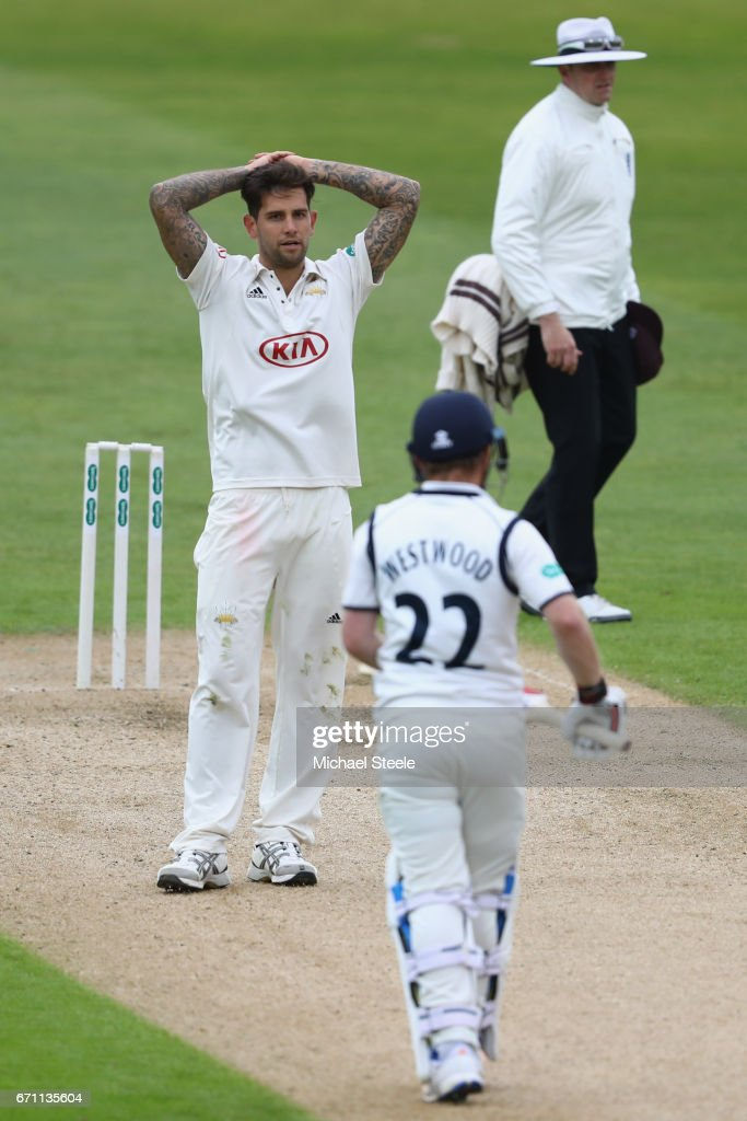 Jade Dernbach of Surrey shows his frustration after Ian Westwood of Warwickshire looks on during day one of the Specsavers County Championship Division One match between Warwickshire and Surrey at Edgbaston on April 21, 2017 in Birmingham, England.