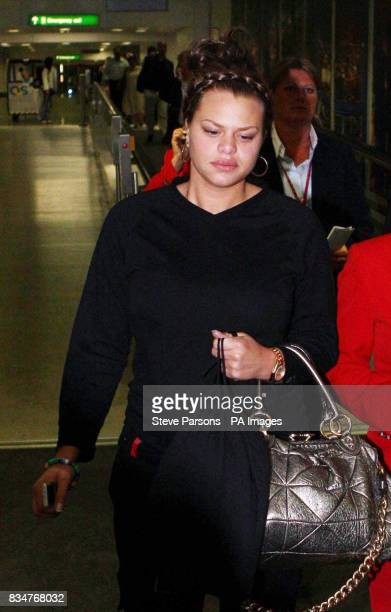 Jade Goody arrives at Heathrow after leaving the Indian Big Brother house where she learnt that she had been diagnosed with cervical cancer
