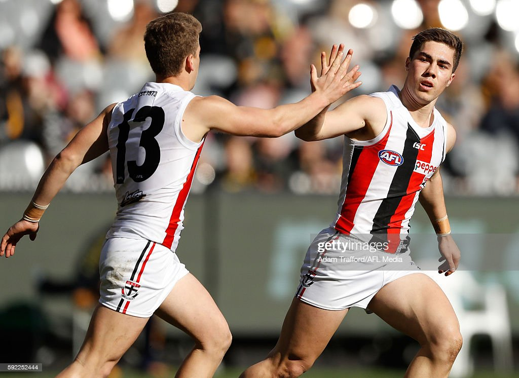 Jade Gresham of the Saints celebrates a goal with Jack Lonie of the Saints during the 2016 AFL Round 22 match between the Richmond Tigers and the St...