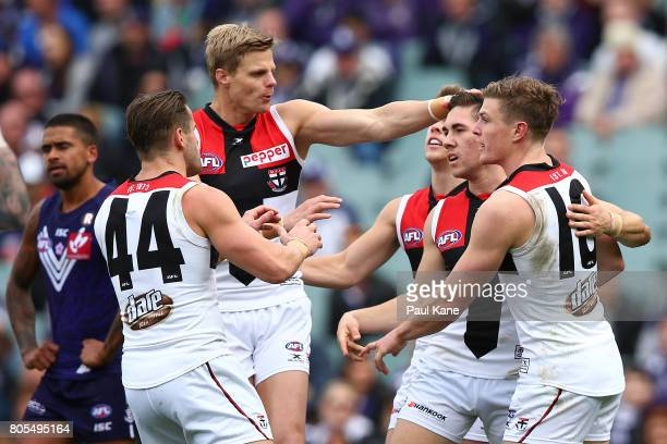 Jade Gresham of the Saints celebrates a goal with Nick Riewoldt and Jack Newnes during the round 15 AFL match between the Fremantle Dockers and the...