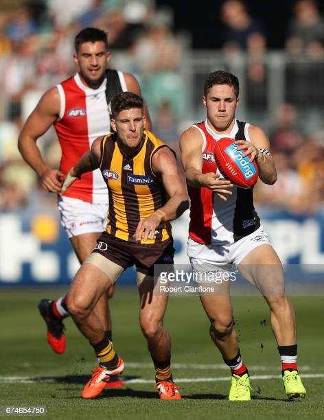 Jade Gresham of the Saints controls the ball during the round six AFL match between the Hawthorn Hawks and the St Kilda Saints at University of...