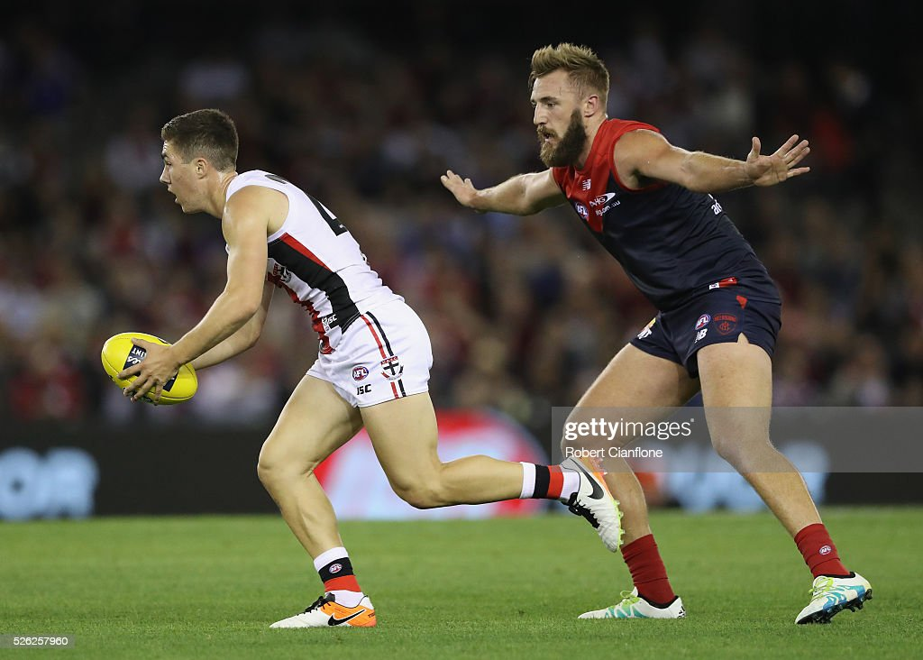 Jade Gresham of the Saints gets away from Lynden Dunn of the Demons during the round six AFL match between the Melbourne Demons and the St Kilda Saints at Etihad Stadium on April 30, 2016 in Melbourne, Australia.