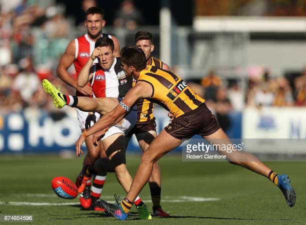 Jade Gresham of the Saints has his kick smothered by Daniel Howe of the Hawks during the round six AFL match between the Hawthorn Hawks and the St...