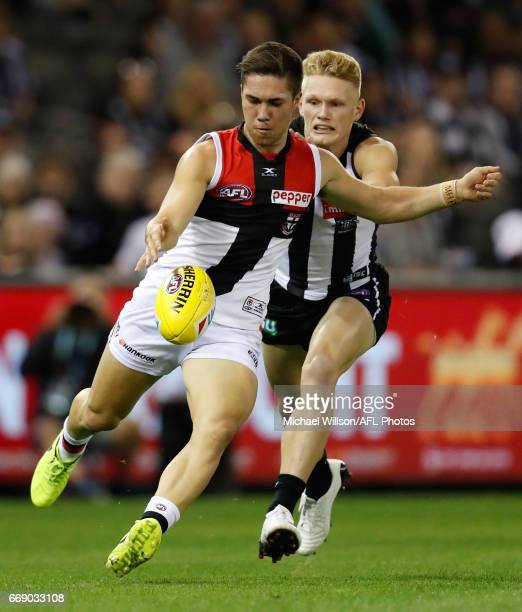 Jade Gresham of the Saints is tackled by Adam Treloar of the Magpies during the 2017 AFL round 04 match between the Collingwood Magpies and the St...