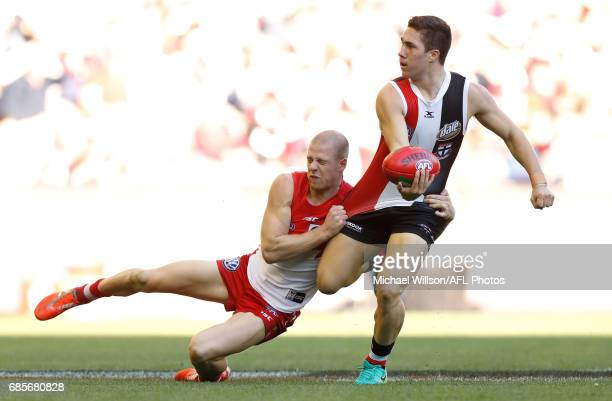 Jade Gresham of the Saints is tackled by Zak Jones of the Swans during the 2017 AFL round 09 match between the St Kilda Saints and the Sydney Swans...