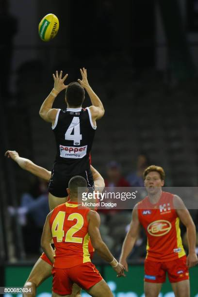 Jade Gresham of the Saints marks the ball during the round 14 AFL match between the St Kilda Saints and the Gold Coast Suns at Etihad Stadium on June...