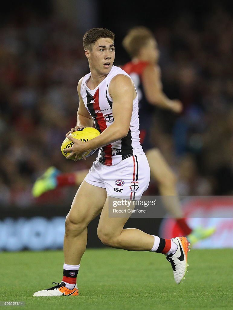 Jade Gresham of the Saints runs with the ball during the round six AFL match between the Melbourne Demons and the St Kilda Saints at Etihad Stadium on April 30, 2016 in Melbourne, Australia.