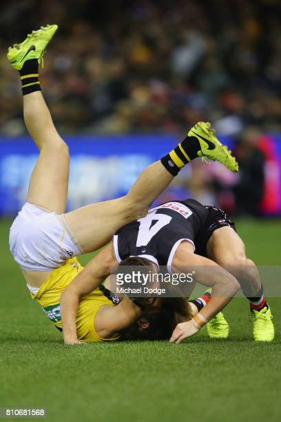 Jade Gresham of the Saints tackles Trent Cotchin of the Tigers during the round 16 AFL match between the St Kilda Saints and the Richmond Tigers at...
