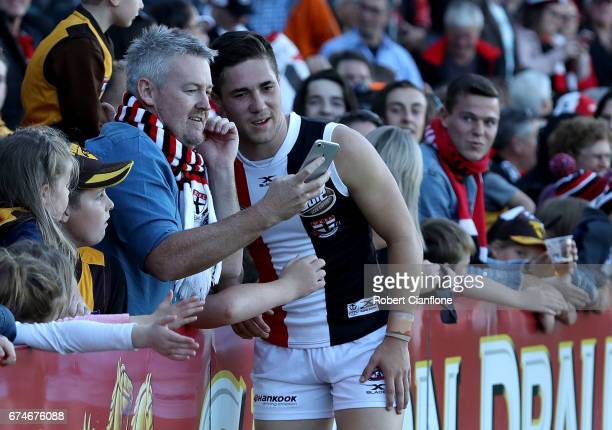 Jade Gresham of the Saints takes a photo with a fan after the Saints defeated the Hawks during the round six AFL match between the Hawthorn Hawks and...