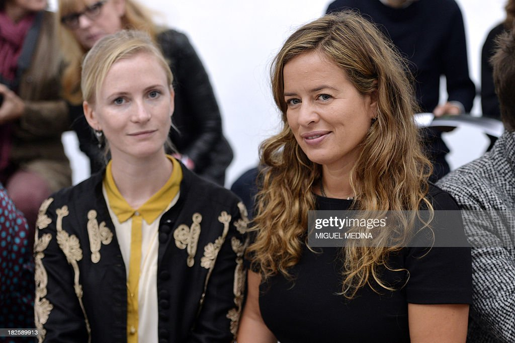 Jade Jagger, (R), daughter of Rolling Stones lead singer, poses prior to the start of the Agnes B. 2014 Spring/Summer ready-to-wear collection fashion show, on October 1, 2013 in Paris. AFP PHOTO / MIGUEL MEDINA