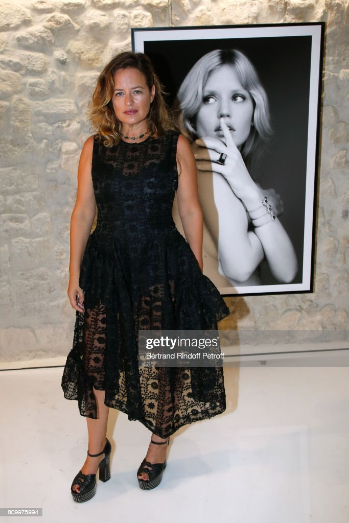 Jade Jagger poses in front of picture of her sister Georgia May Jagger during the 'Don't Take it Personally' by Jade Jagger & Jean-Baptiste Pauchard Exhibition Party on July 6, 2017 in Paris, France.