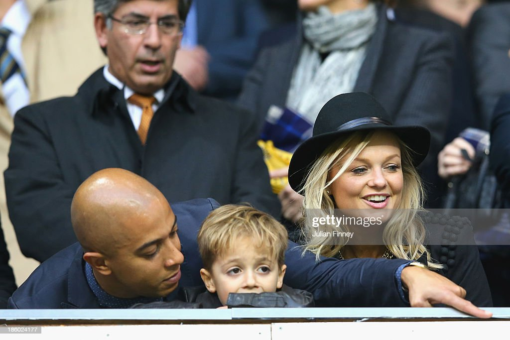Jade Jones and Emma Bunton look on during the Barclays Premier League match between Tottenham Hotspur and Hull City at White Hart Lane on October 27, 2013 in London, England.