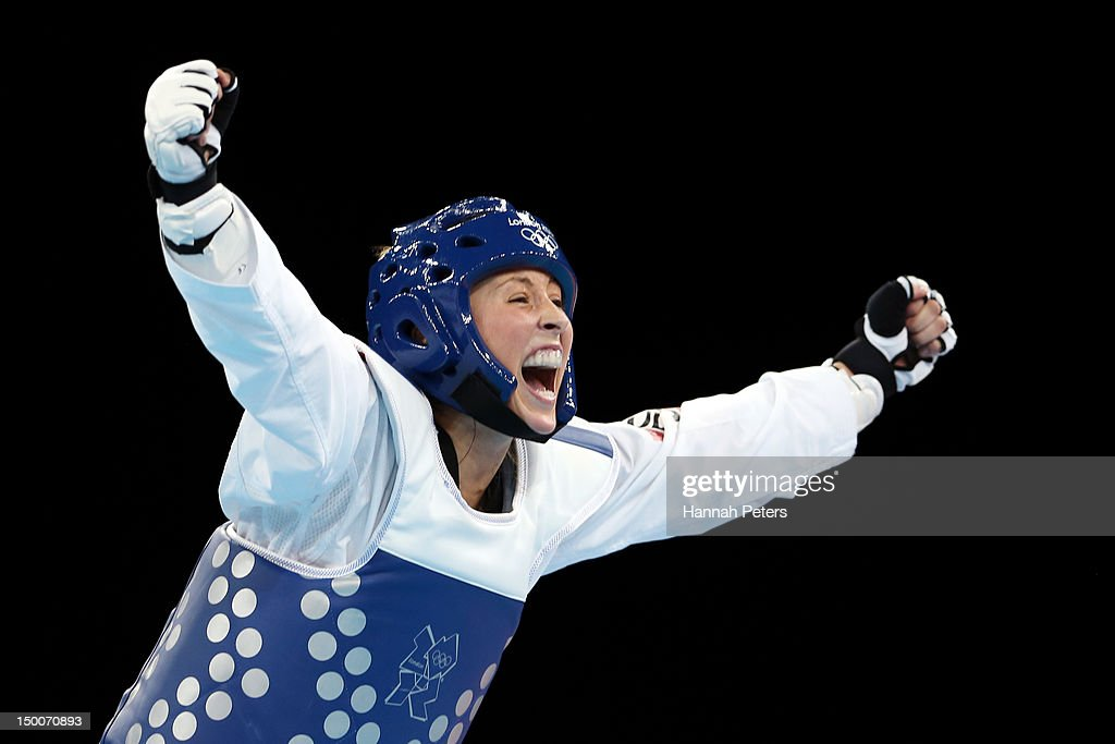 Jade Jones of Great Britain celebrates defeating Yuzhuo Hou of China during the Women's 57kg Taekwondo gold medal final on Day 13 of the London 2012...