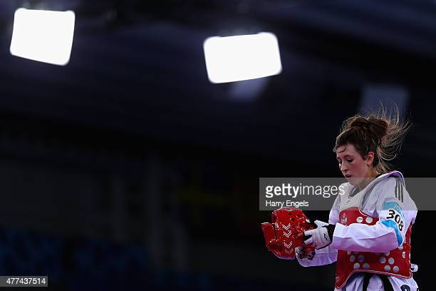 Jade Jones of Great Britain removes her helmet after defeating Edina Kotsis of Hungary during the Women's Taekwondo 57kg quarterfinal during day five...