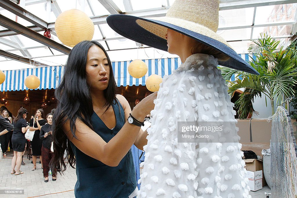 Jade Lai dresses a model backstage at Creatures of Comfort Presentation at Maritime Hotel on September 8, 2013 in New York City.
