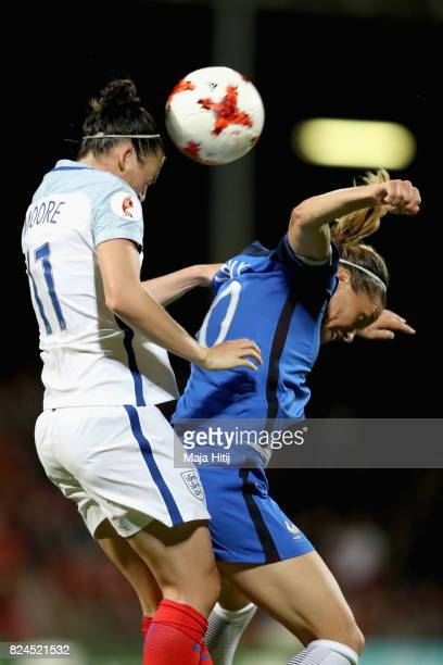 Jade Moore of England and Camille Abily of France battle to win a header during the UEFA Women's Euro 2017 Quarter Final match between France and...