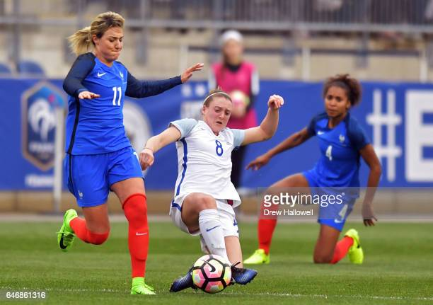 Jade Moore of England kicks the ball away from Claire Lavogez of France as Laura Georges looks on during the SheBelieves Cup at Talen Energy Stadium...