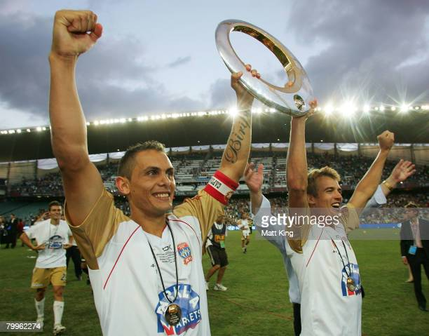 Jade North and Joel Griffiths of the Jets hold up the ALeague trophy after victory in the ALeague Grand Final match between the Central Coast...