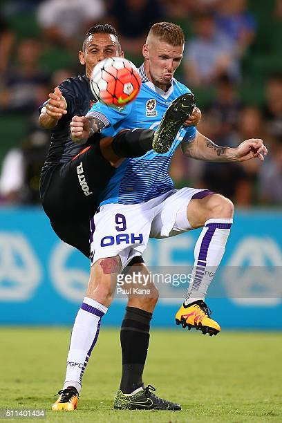 Jade North of the Roar and Andy Keogh of the Glory contest for the ball during the round 20 ALeague match between the Perth Glory and Brisbane Roar...