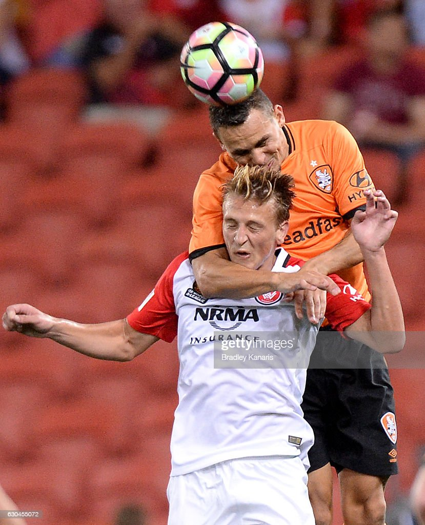 Jade North of the Roar and Lachlan Scott of the Wanderers challenge for the ball during the round 22 A-League match between Brisbane Roar and Western Sydney Wanderers at Suncorp Stadium on December 23, 2016 in Brisbane, Australia.
