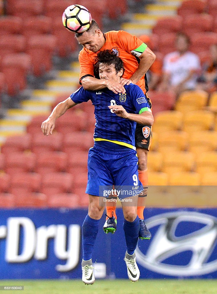Jade North of the Roar and Misagh Bahadoran of Global FC challenge for the ball during the Asian Cup Champions League Qualifying Match between Brisbane Roar and Global FC at Suncorp Stadium on January 31, 2017 in Brisbane, Australia.