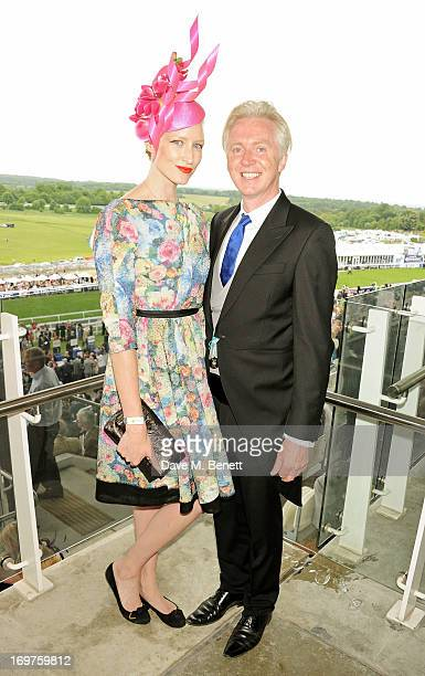 Jade Parfitt and Philip Treacy attend Derby Day at the Investec Derby Festival at Epsom Racecourse on June 1 2013 in Epsom United Kingdom