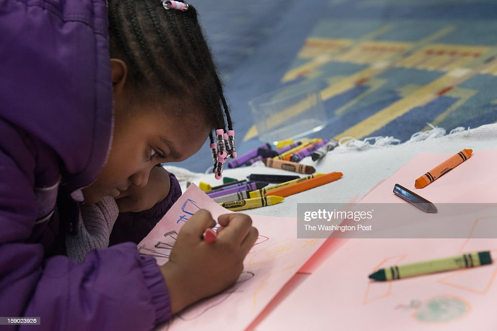 WASHINGTON, DC - JANUARY 5 Jade Ponger, 4, of DC uses crayons at one of the charter school booths. The 4th Annual DC Public Charter School Expo was held on Saturday, January 5th, 2013 at the Washington Convention Center brought together the local charter school community, parents, prospective teachers, community members and vendors. The Expo is hosted by the DC Public Charter School Board (PCSB), the DC Association of Chartered Public Schools (DCACPS) and Friends of Choice in Urban Schools (FOCUS).