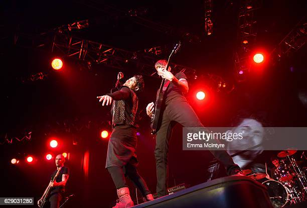 Jade Puget Davey Havok and Hunter Burgan of the band AFI perform onstage at 1067 KROQ Almost Acoustic Christmas 2016 Night 1 at The Forum on December...