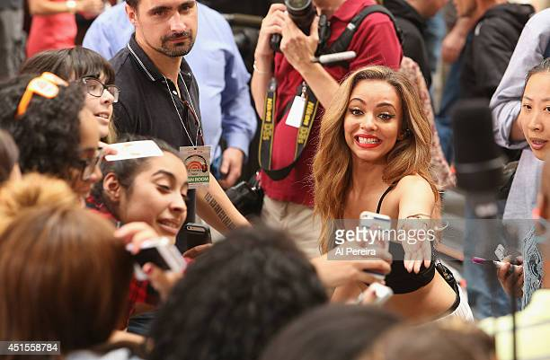 Jade Thirlwall meets a young fan when Little Mix takes selfies and signs autographs when they perform on NBC's 'Today' at Rockefeller Plaza on June...