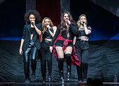 Jade Thirlwall Perrie Edwards Jesy Nelson and LeighAnne Pinnock of Little Mix performs in concert at The Palace of Auburn Hills on March 13 2014 in...
