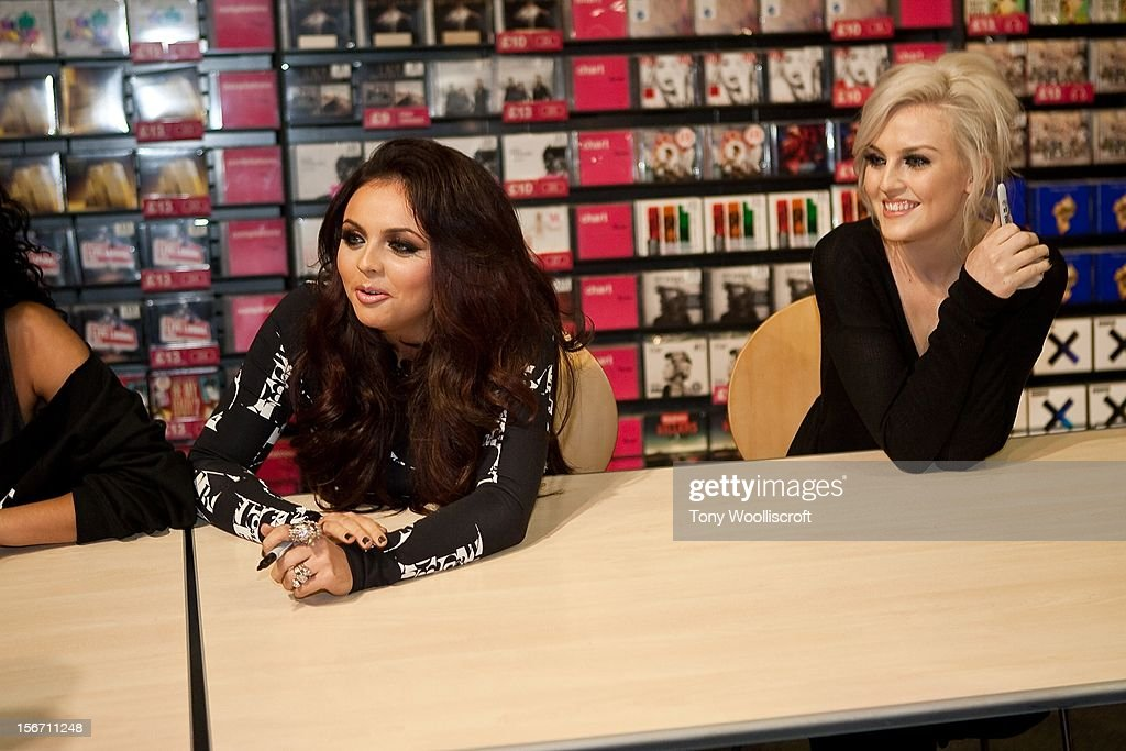 Jade Thirwell and Perrie Edwards of Little Mix meet fans and sign copies of their album 'DNA' on November 19, 2012 in Birmingham, England.