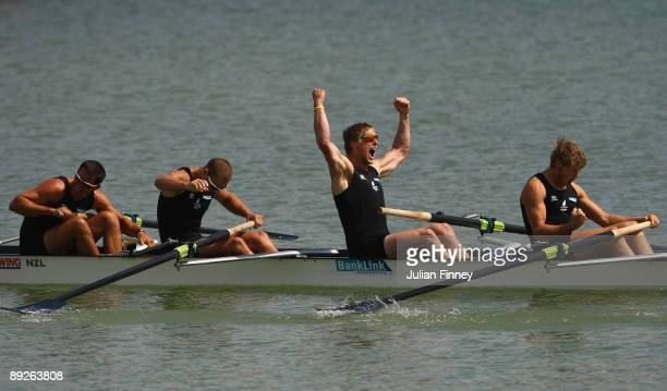 Jade Uru Simon Watson Hamish Burson and Tyson Williams of New Zealand celebrate winning gold after the Mens Four Final during day four of the FISA...