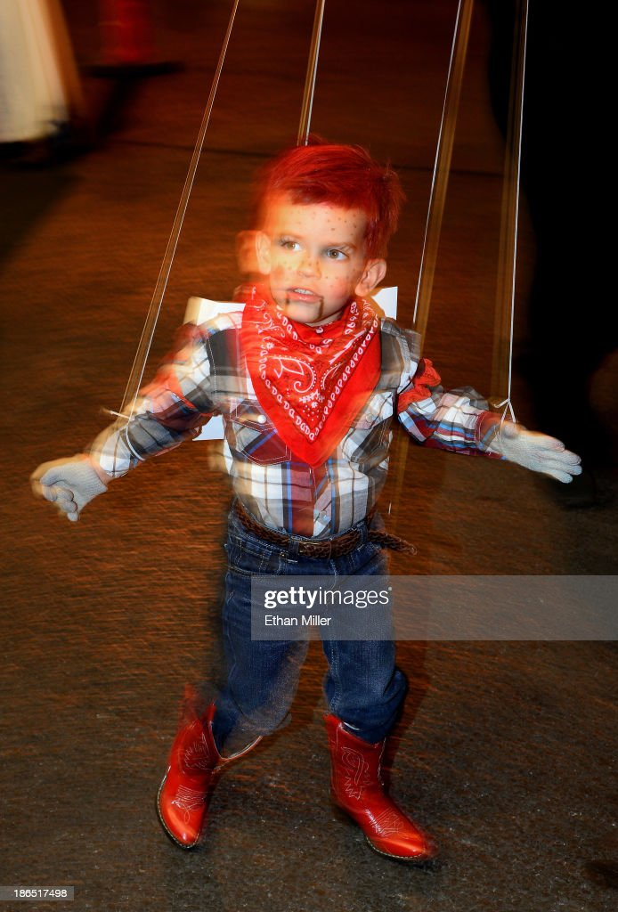 Jaden Brittell, 3, of Nevada wears a Howdy Doody outfit as he competes in a costume contest during the fourth annual Las Vegas Halloween Parade on October 31, 2013 in Las Vegas, Nevada.