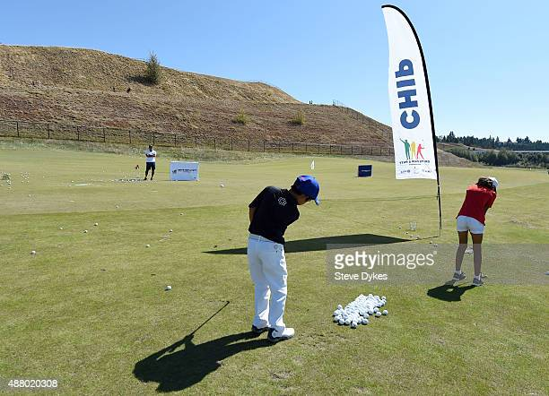 Jaden Dumdumaya practices his chipping before the Drive Chip and Putt regional qualifying at Chambers Bay on September 12 2015 in University Place...