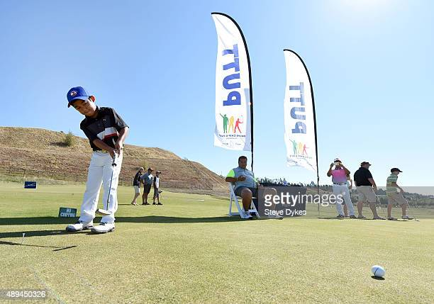 Jaden Dumdumaya practices his putting before competing in the Boys 7 yr old Drive Chip and Putt regional qualifying at Chambers Bay on September 12...