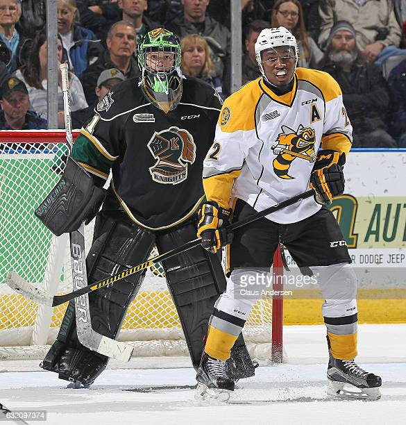 Jaden Lindo of the Sarnia Sting looks to tip a shot in front of Tyler Parsons of the London Knights during an OHL game at Budweiser Gardens on...
