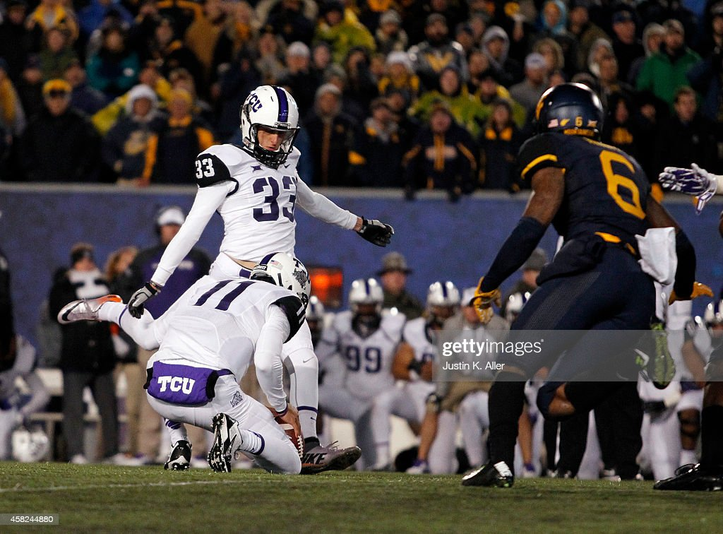 Jaden Oberkrom of the TCU Horned Frogs kicks the game winning field goal in the fourth quarter during the game against the West Virginia Mountaineers...