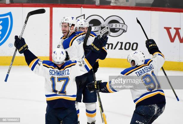 Jaden Schwartz Ivan Barbashev and Vladimir Tarasenko of the St Louis Blues congratulate teammate Joel Edmundson on scoring the gamewinning goal...