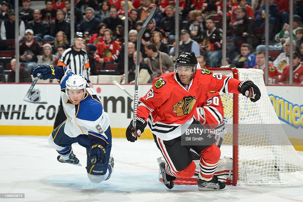 Jaden Schwartz #9 of the St. Louis Blues and Johnny Oduya #27 of the Chicago Blackhawks race toward the puck during the NHL game on January 22, 2013 at the United Center in Chicago, Illinois.