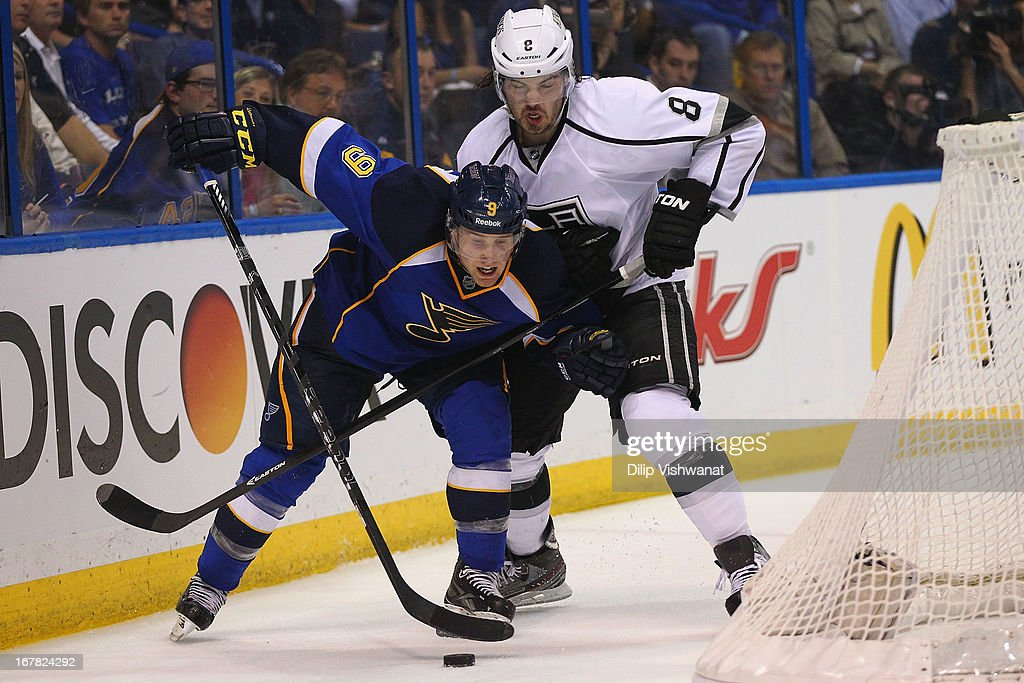 Jaden Schwartz #9 of the St. Louis Blues battles Drew Doughty #8 of the Los Angeles Kings for control of the puck in Game One of the Western Conference Quarterfinals during the 2013 NHL Stanley Cup Playoffs at the Scottrade Center on April 30, 2013 in St. Louis, Missouri. The Blues beat the Kings 2-1 in overtime.