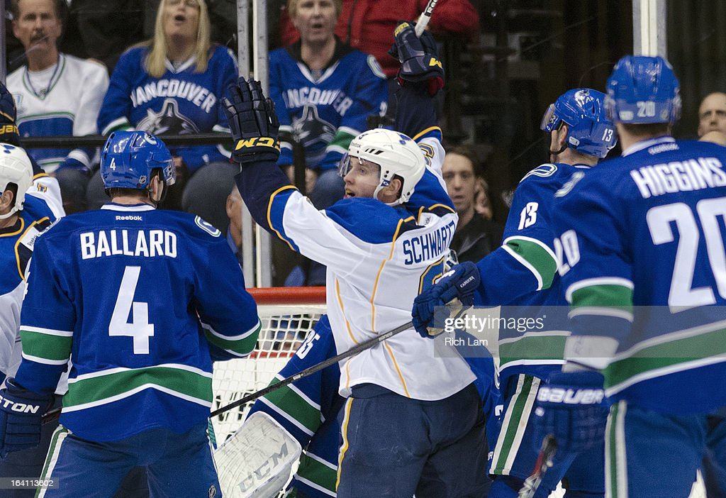 Jaden Schwartz #9 of the St. Louis Blues celebrates after scoring a goal as Keith Ballard #4, Steven Pinizzotto #13 and Chris Higgins #20 of the Vancouver Canucks look on during the third period in NHL action on March 19, 2013 at Rogers Arena in Vancouver, British Columbia, Canada.