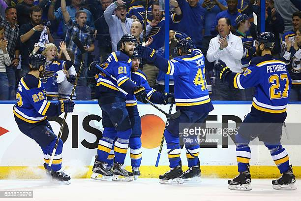 Jaden Schwartz of the St Louis Blues celebrates with Patrik Berglund and David Backes after scoring a first period goal against the San Jose Sharks...