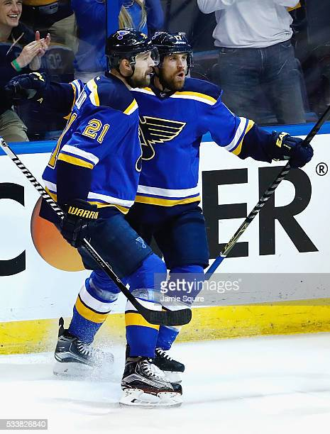 Jaden Schwartz of the St Louis Blues celebrates with Patrik Berglund after scoring a first period goal against the San Jose Sharks in Game Five of...