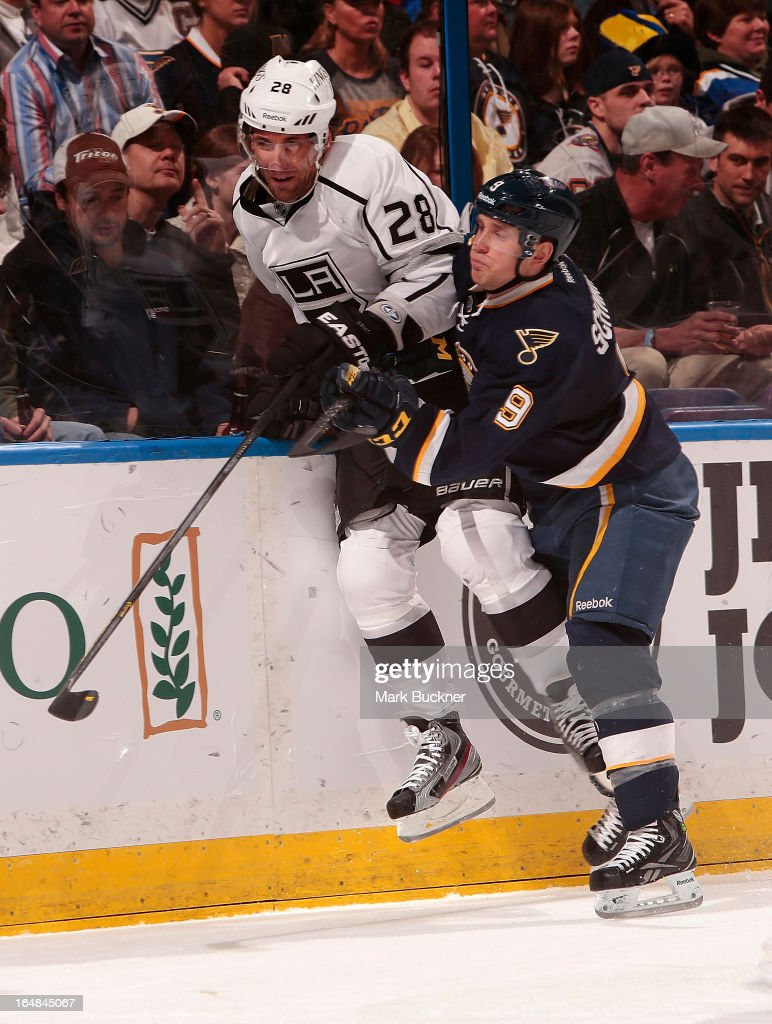 Jaden Schwartz #9 of the St. Louis Blues checks <a gi-track='captionPersonalityLinkClicked' href=/galleries/search?phrase=Jarret+Stoll&family=editorial&specificpeople=204632 ng-click='$event.stopPropagation()'>Jarret Stoll</a> #28 of the Los Angeles Kings in an NHL game on March 28, 2013 at Scottrade Center in St. Louis, Missouri.
