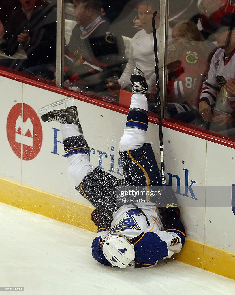 Jaden Schwartz #9 of the St. Louis Blues ends up on his back after crashing into the boards against the Chicago Blackhawks at the United Center on January 22, 2013 in Chicago, Illinois.