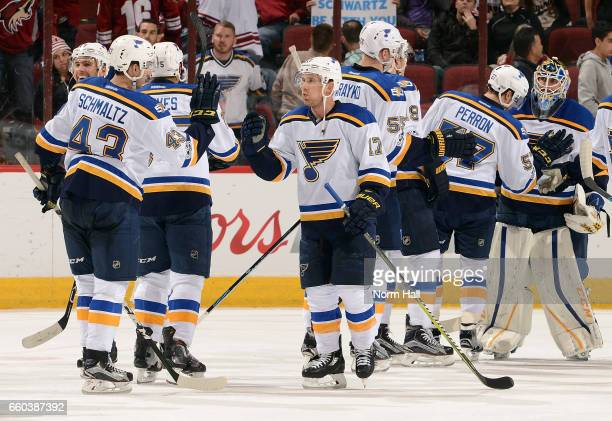 Jaden Schwartz of the St Louis Blues is congratulated by Jordan Schmaltz and teammates following a 31 victory against the Arizona Coyotes at Gila...